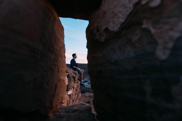 overcoming adversity - man on cliff