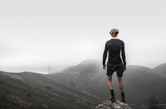 overcoming adversity - man hiking