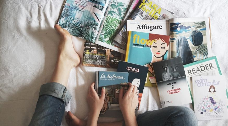 truths about life - magazines on bed
