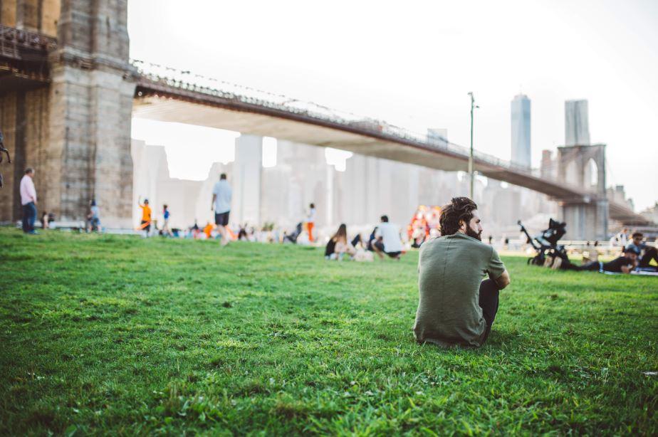 getting things done - man under Brooklyn Bridge