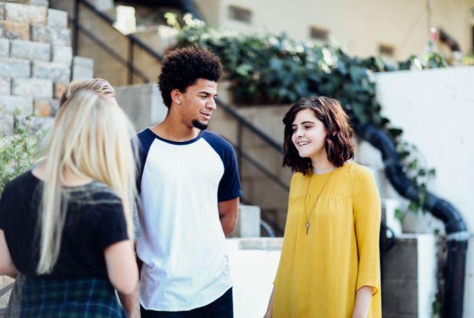 three friends talking - break up with a friend