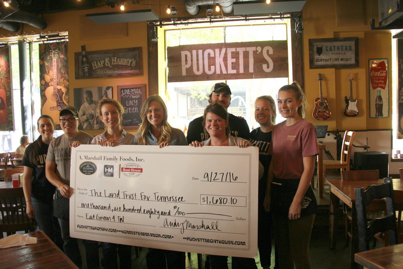 Puckett's presents check to Land Trust for Eat Green campaign
