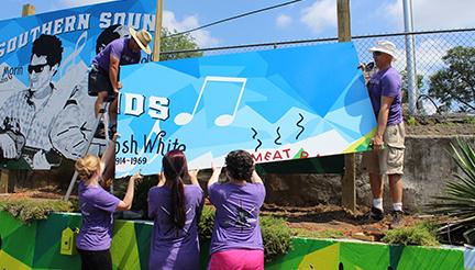 Installation of Horizon Records mural honoring Greenville musician Russ Morin.