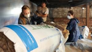 Community_Conservation_Corps_volunteers install insulation 600
