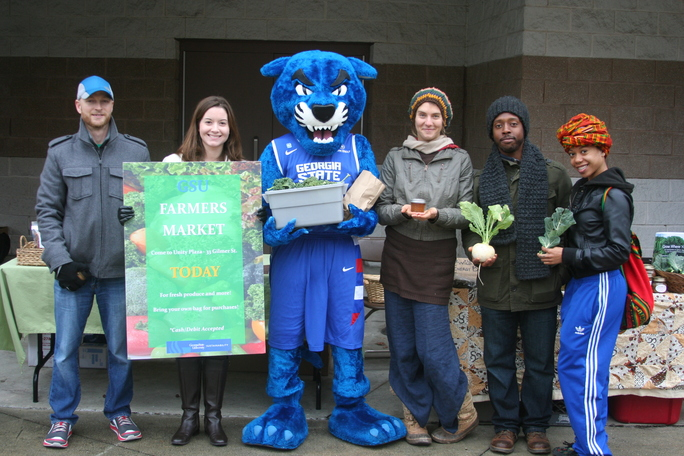 Asman with Pounce and GSU students at the inaugural Georgia State Farmers Market