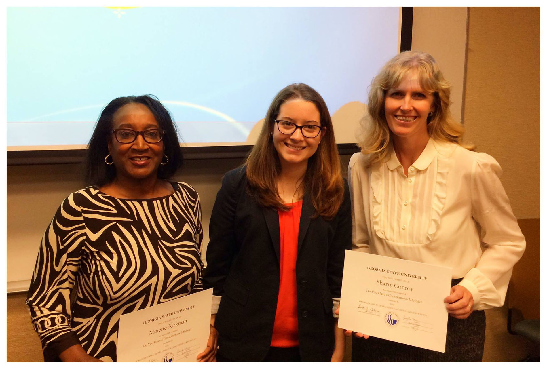 Two GSU staff members receive their certificates after successfully completing the Georgia State Staff Sustainability Certification Training.