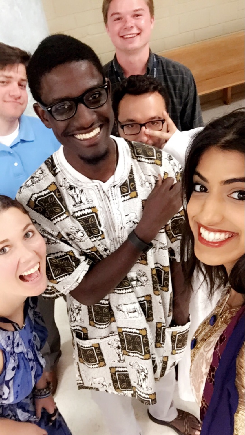 Alexi Muhumure (center) and fellow interns celebrate World Refugee Day