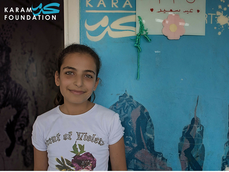 A young refugee named Iman who was able to attend school in Turkey with the help of the Karam Foundation.