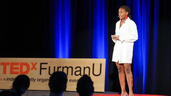 Furman student Nomonde Gila '19 speaks during TedXFurmanU. (size: funews-syndication)