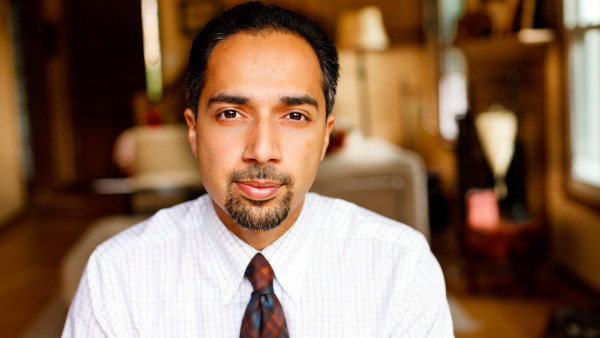 portrait of a man with dark hair and a goatee wearing a white shirt and a tie. (size: funews-syndication)