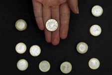 Global_economy_coins_reuters_column