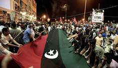 Libya-protest-flag-cnn-afp-getty-235x135_column