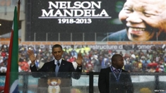 Obama_at_mandela_service_column
