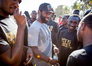 Revis_with_kids_preview