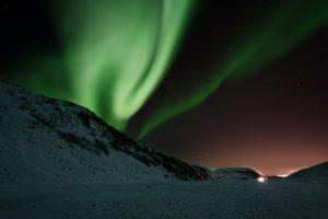 Surfing Under the Northern Lights