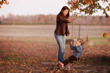 Family photograph in field by Jennifer Warthan Photography