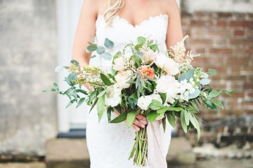 Bridal portrait with floral bouquet by The Reason Photography