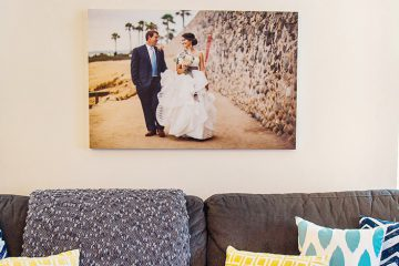 Canvas print hanging over couch in home