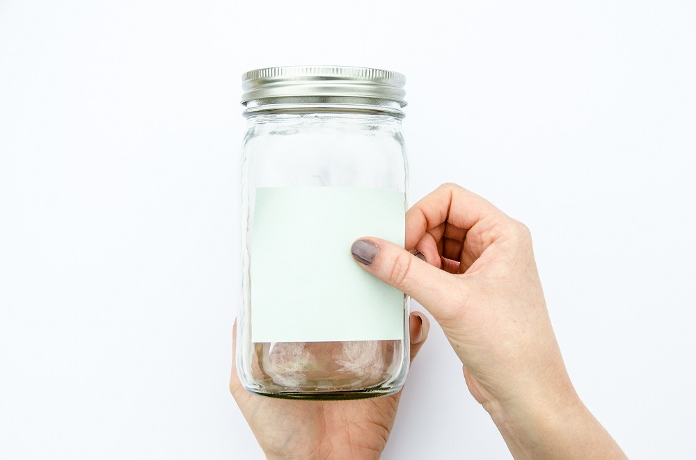 Placing post-it note on outside of mason jar