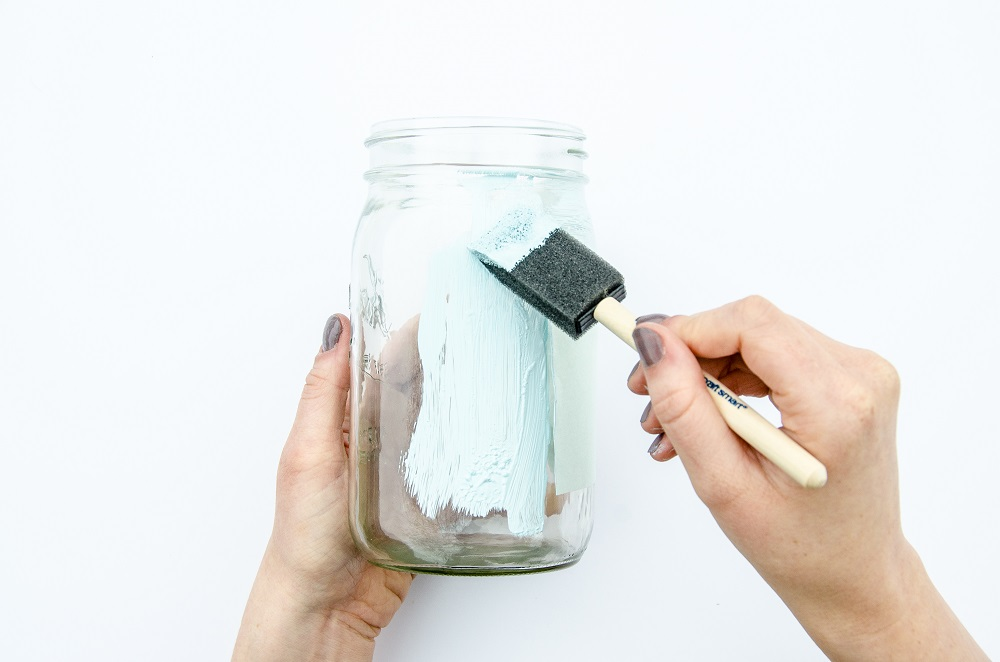 Painting outside of mason jar with foam paint brush