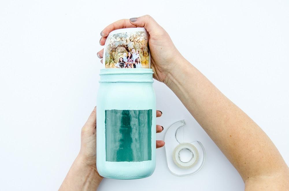 Placing photo print in mason jar