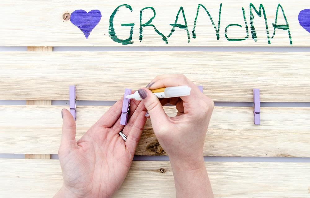 Glue mini clothespins to the board