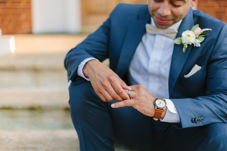 Groom looking at his new wedding ring
