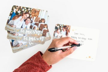 Writing holiday card to armed force member