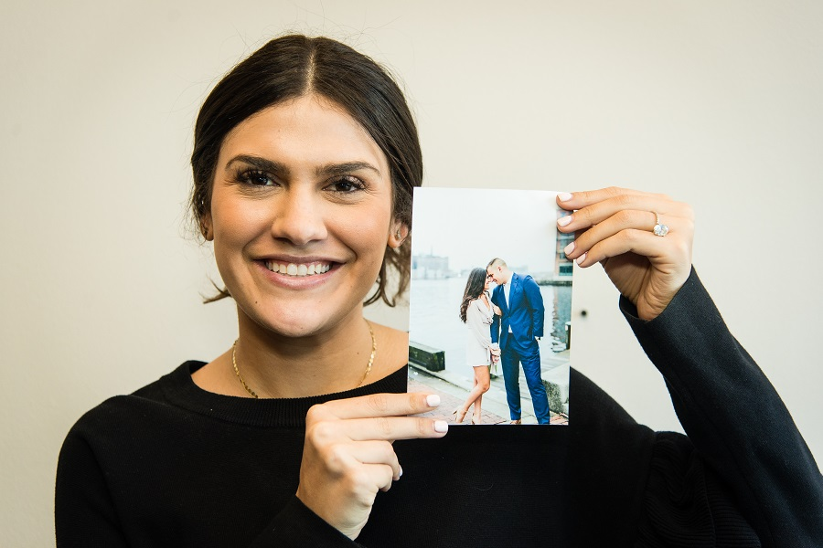 Holding up engagement photo