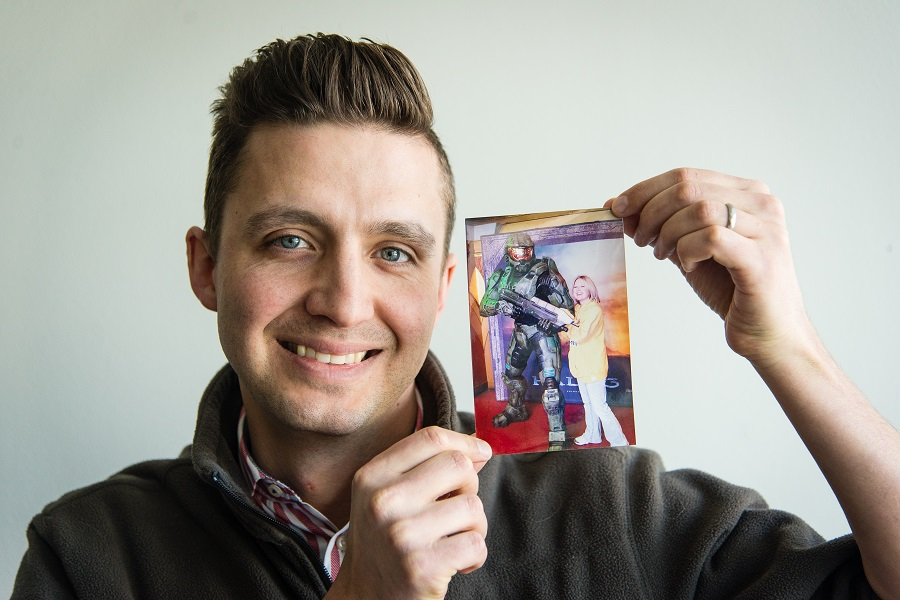 holding up photo of wife