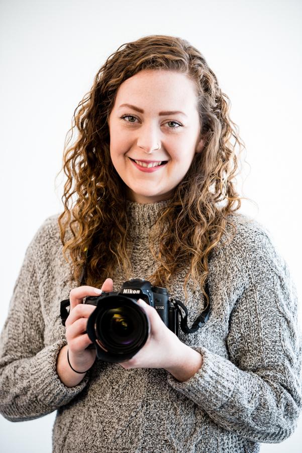 Photographer holding camera