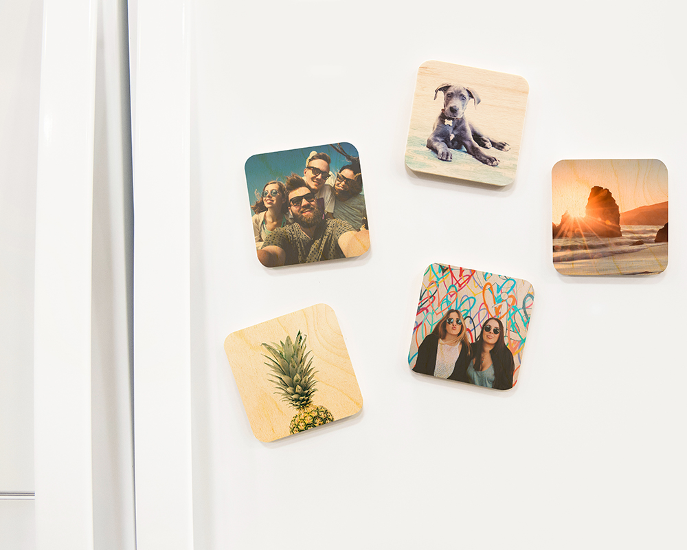 Wood photo magnets on fridge