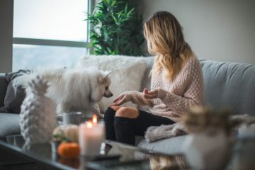 Woman in apartment with dog