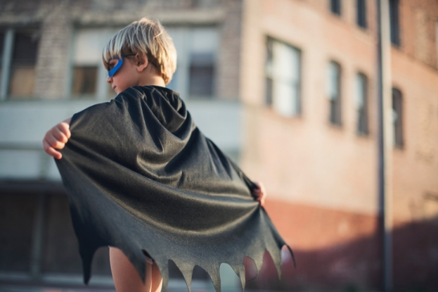 Young boy dressed as superhero on Halloween