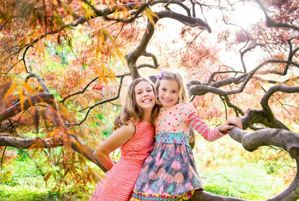 girls smiling in the fall