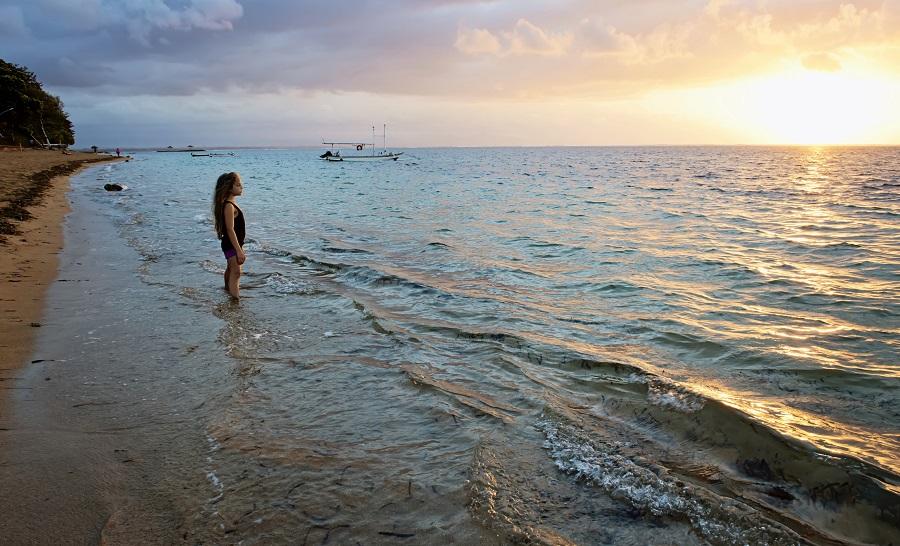 shoreline with child in ocean