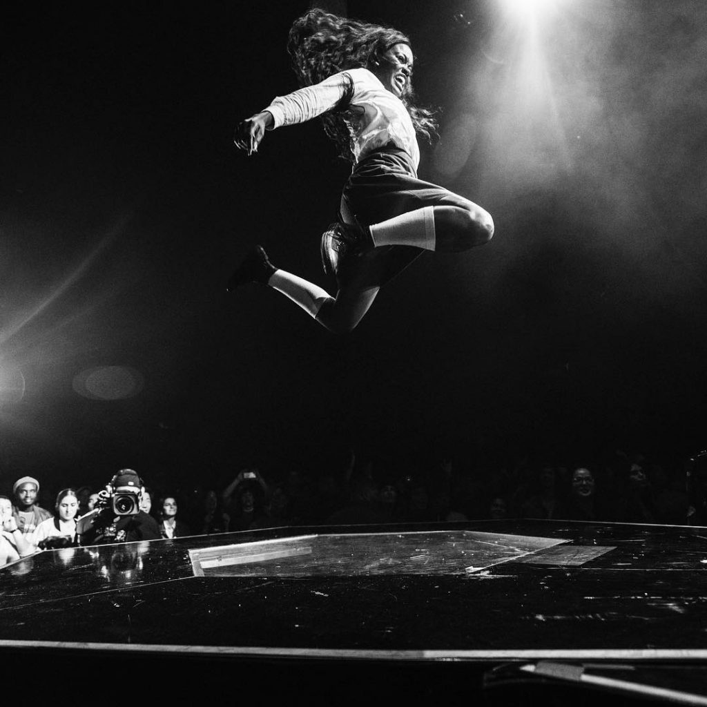 Dancer at concert jumps