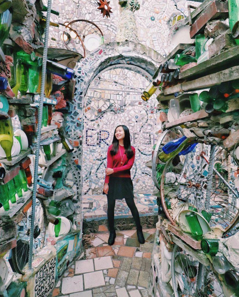 Woman standing in Magic Gardens in Philadelphia, PA