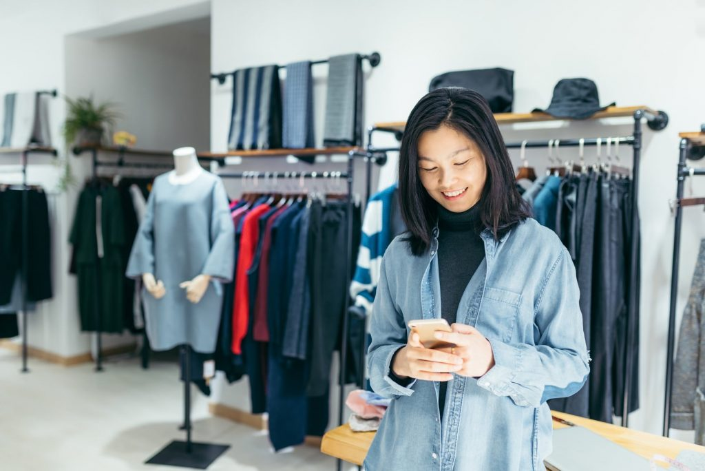 retail employee on phone