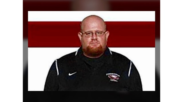 Florida high school coach described as 'hero' died while shielding students