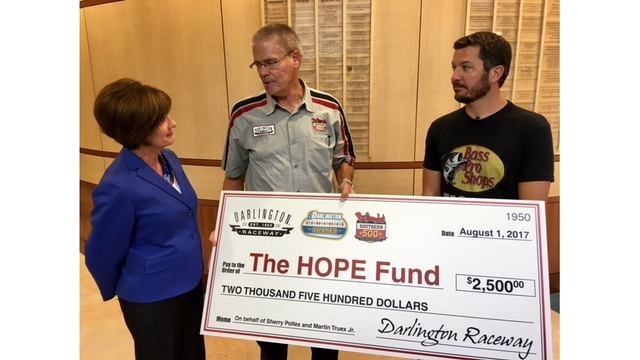 NASCAR driver visits McLeod Health to present donation