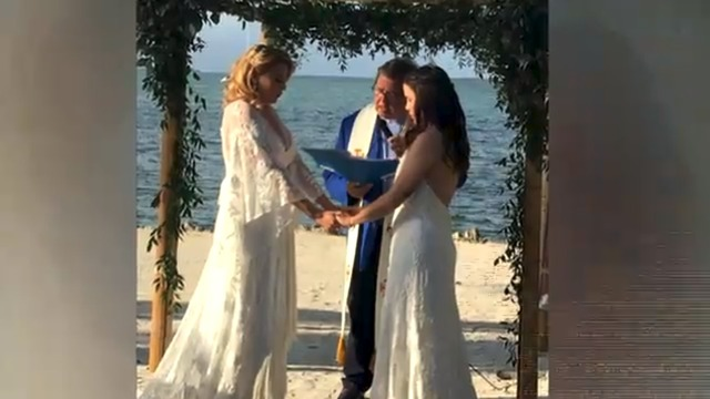 Gay teacher fired after posting her wedding photos online