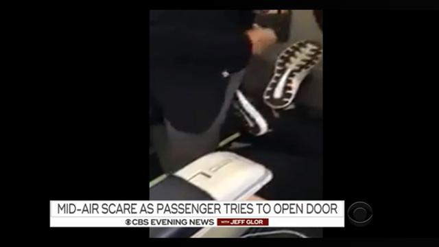 Flight lands safely after woman tries to open door in midair
