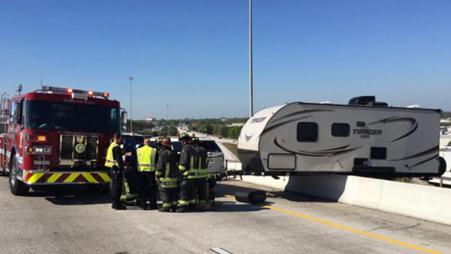 Camper dangles off interstate overpass in Florida after crash