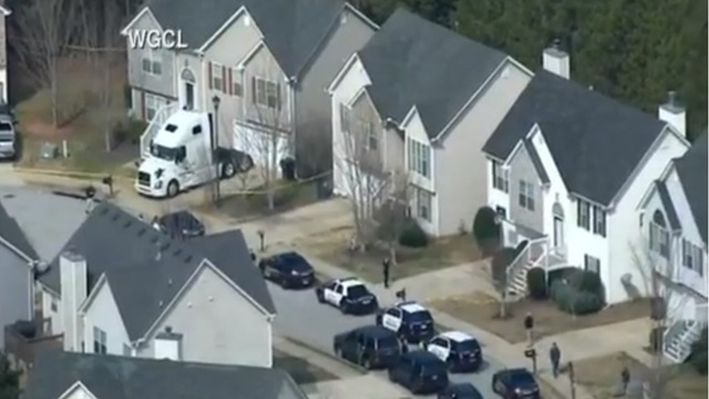Police officer shot dead, two deputies wounded serving warrant in Georgia