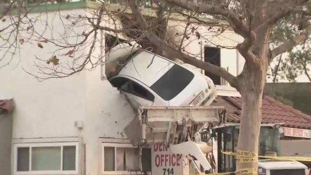 VIDEO: Car goes airborne, slams into 2nd floor of dental office