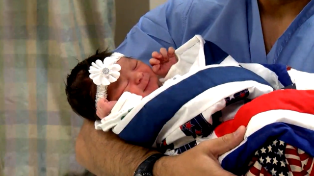 Anonymous couple donates red, white and blue baby quilt to veteran's newborn