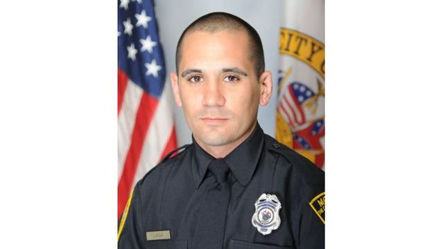 Mobile police officer shot, taken to USA Medical Center
