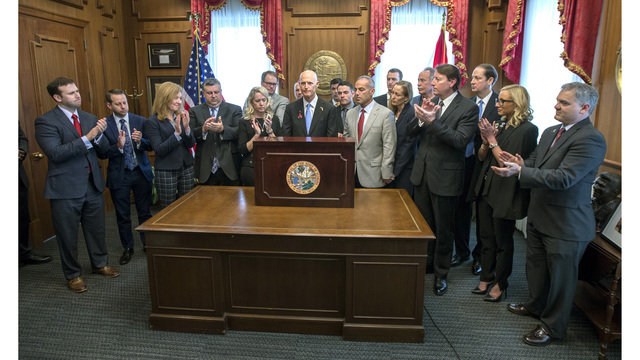 Florida Gov. Rick Scott signs compromise gun control bill