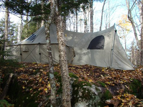 """This hunter's """"drop camp"""" was established back in the woods atop a large glacial erratic. (Photo — Joe Hackett)"""